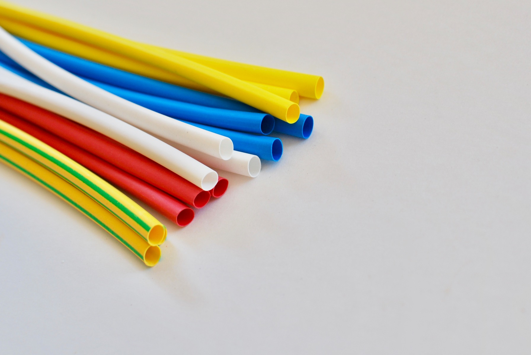 Several colors of heat shrink tubing with very similar sizes.